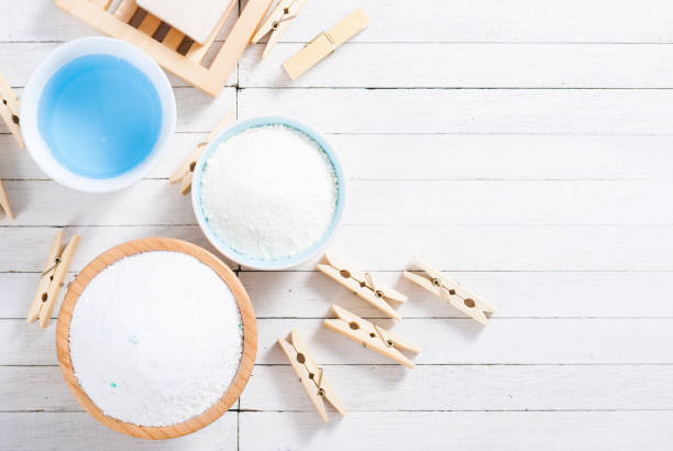 Liquid and powder detergents different washing powders, liquid and soap with clothes pins on white wood laundry detergent stock pictures, royalty-free photos & images