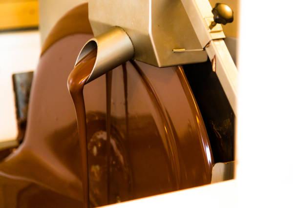 Liquid chocolate mixer in chocolate factory stock photo