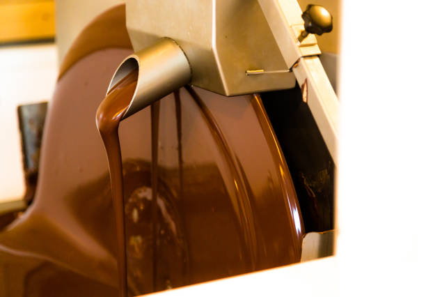 Liquid chocolate mixer in chocolate factory stock photo