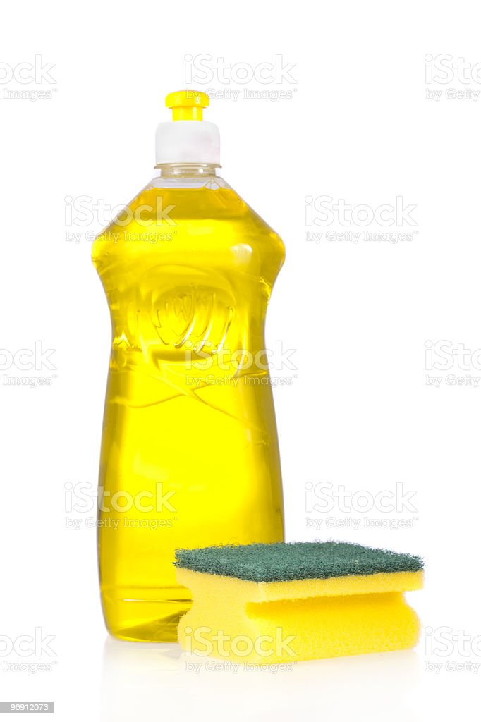 Liquid detergent bottle and scouring pad royalty-free stock photo