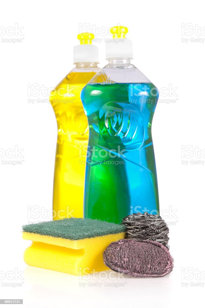 Liquid detergent bottles with scouring pads royalty-free stock photo