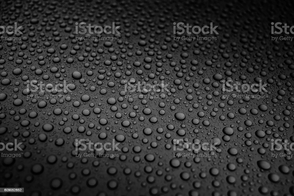 liquid drops of water on metallic surface stock photo