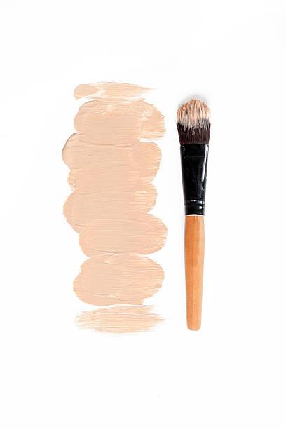 Liquid foundation and brush on white - Photo