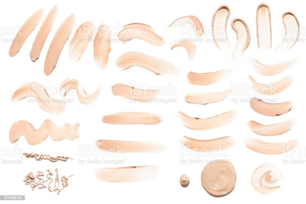 Liquid foundation smear collection stock photo