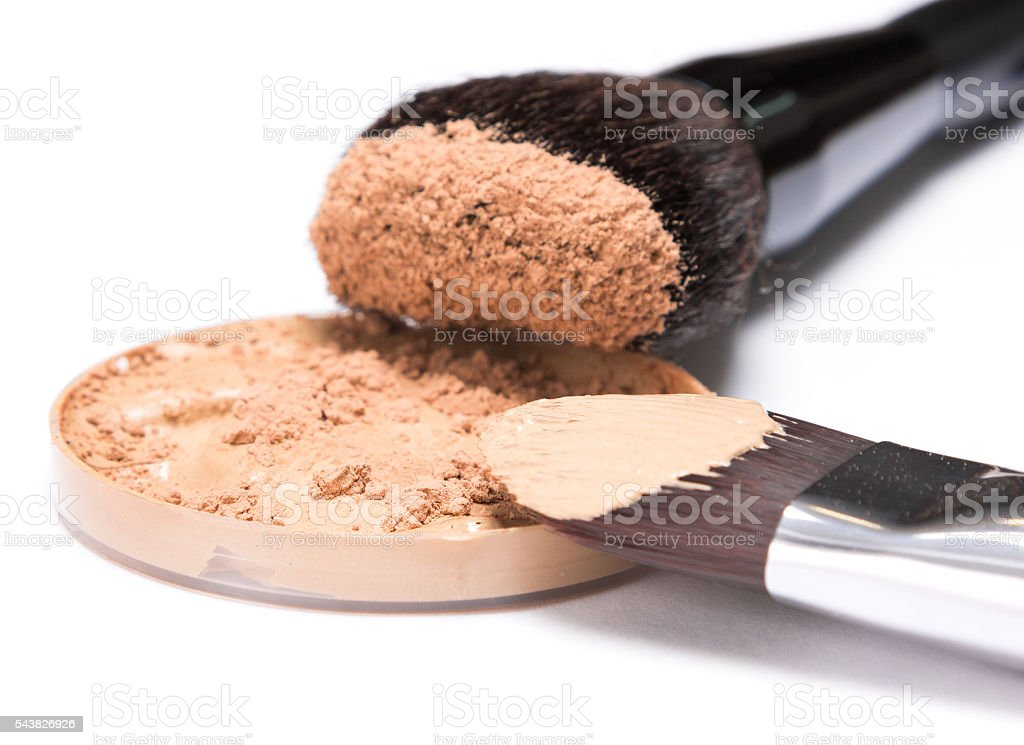 Liquid foundation sprinkled with loose cosmetic powder stock photo