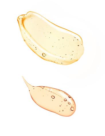 Liquid gel or serum on microscope screen white isolated background