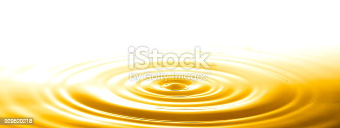 istock Liquid gold drop and ripple ,abstract background 929520218
