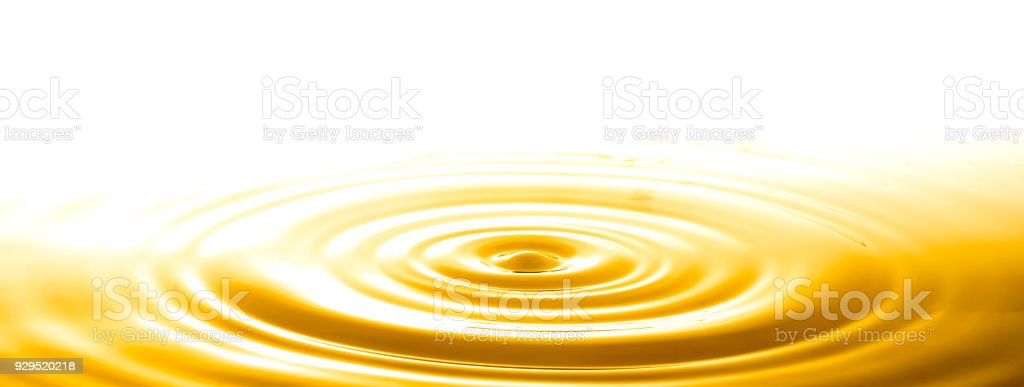 Liquid gold drop and ripple ,abstract background stock photo