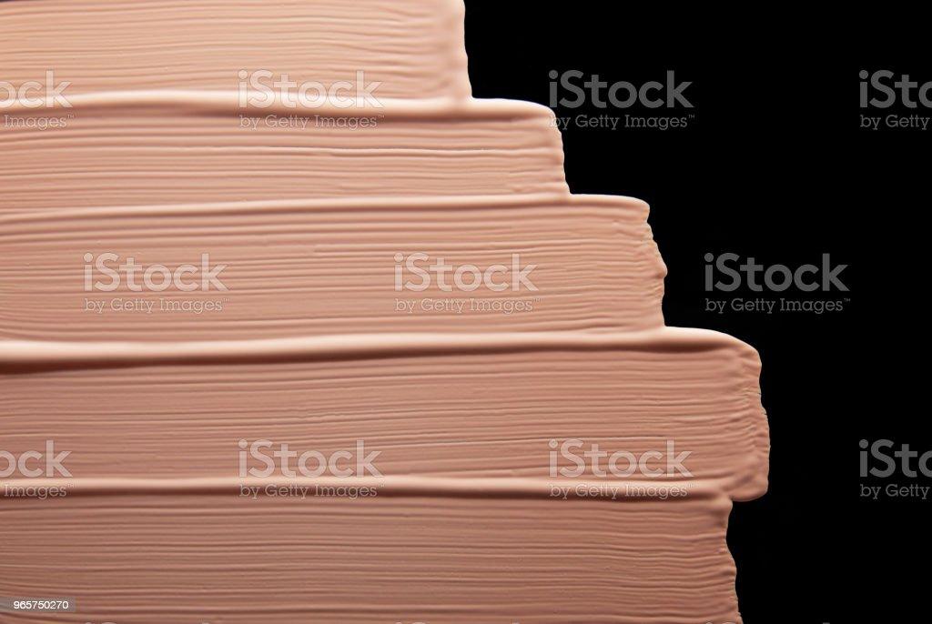 Vloeibare make-up Foundation zwarte achtergrond - Royalty-free Aaien Stockfoto