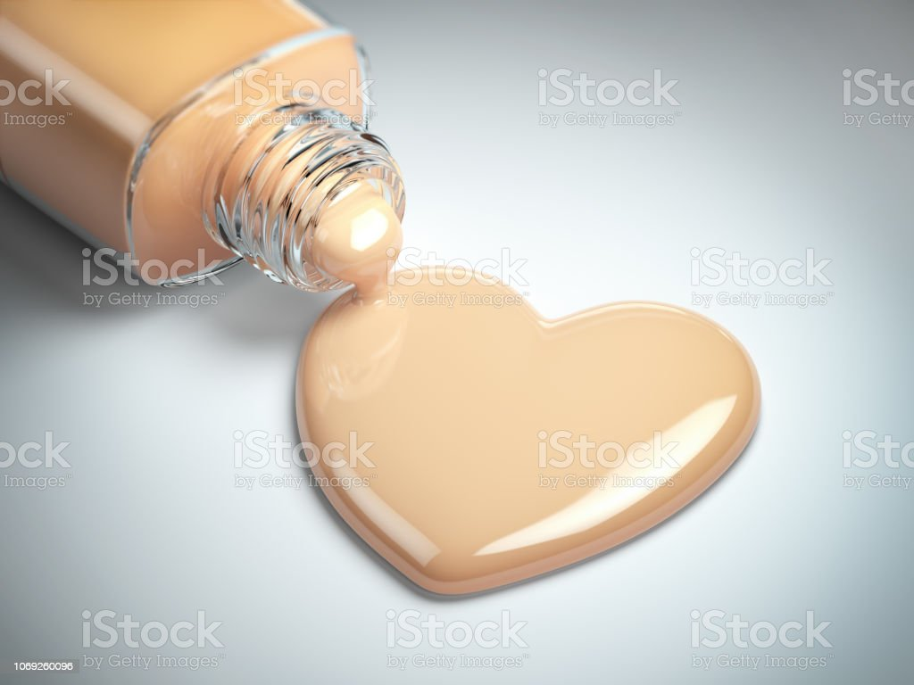 Liquid makeup foundation cream in form of the heart symbol and glass bottle. - Royalty-free Foundation Make-Up Stock Photo