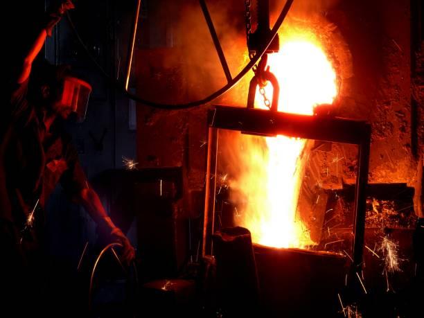 Liquid metal pouring process stock photo