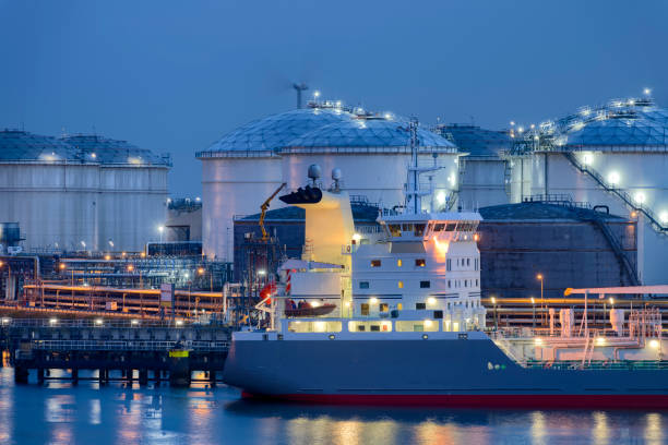 Liquid Natural Gas storage tanks and tanker, Port of Rotterdam stock photo