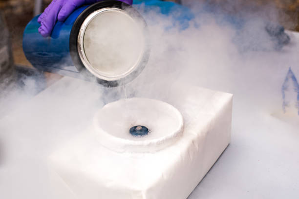 Liquid nitrogen poured for an experiment Liquid nitrogen poured for an experiment liquid nitrogen stock pictures, royalty-free photos & images