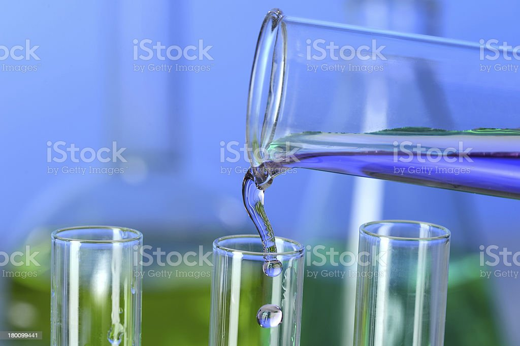 Liquid Pouring into Test Tube royalty-free stock photo