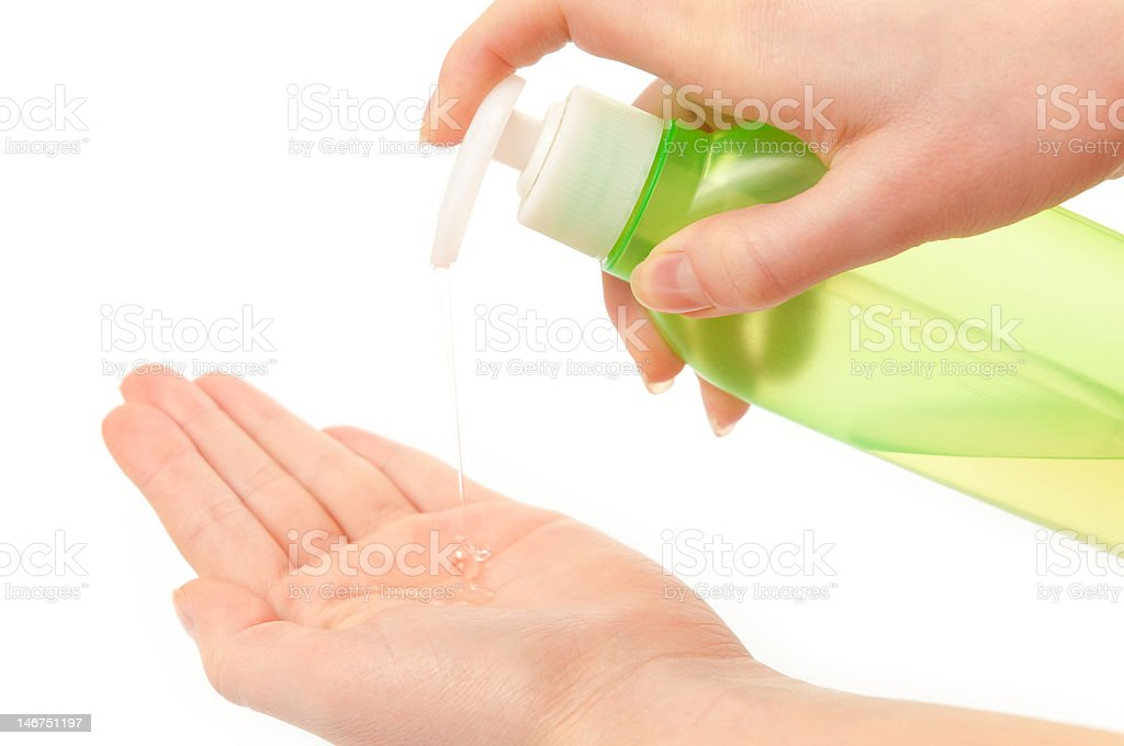 Liquid soap and woman's hands royalty-free stock photo