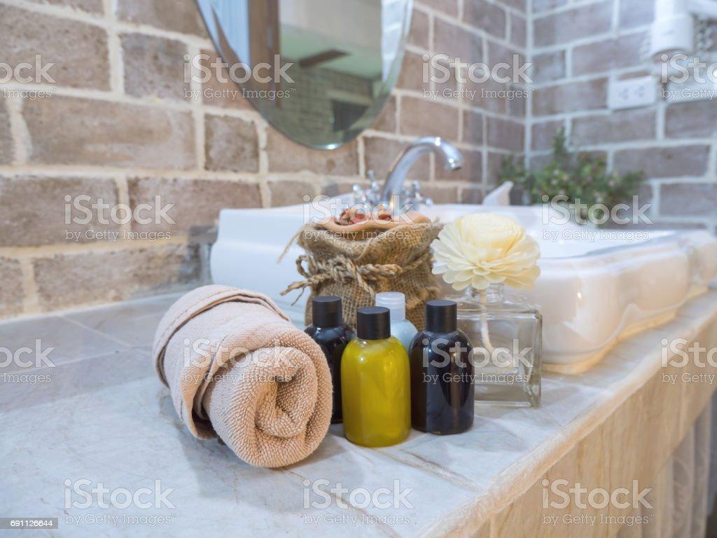 Liquid soap bottle on wash bowl 2 stock photo