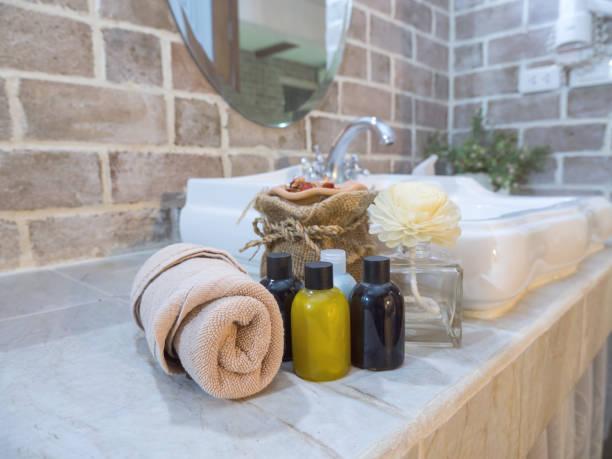 liquid soap bottle on wash bowl 2 - prodotto per l'igiene personale foto e immagini stock