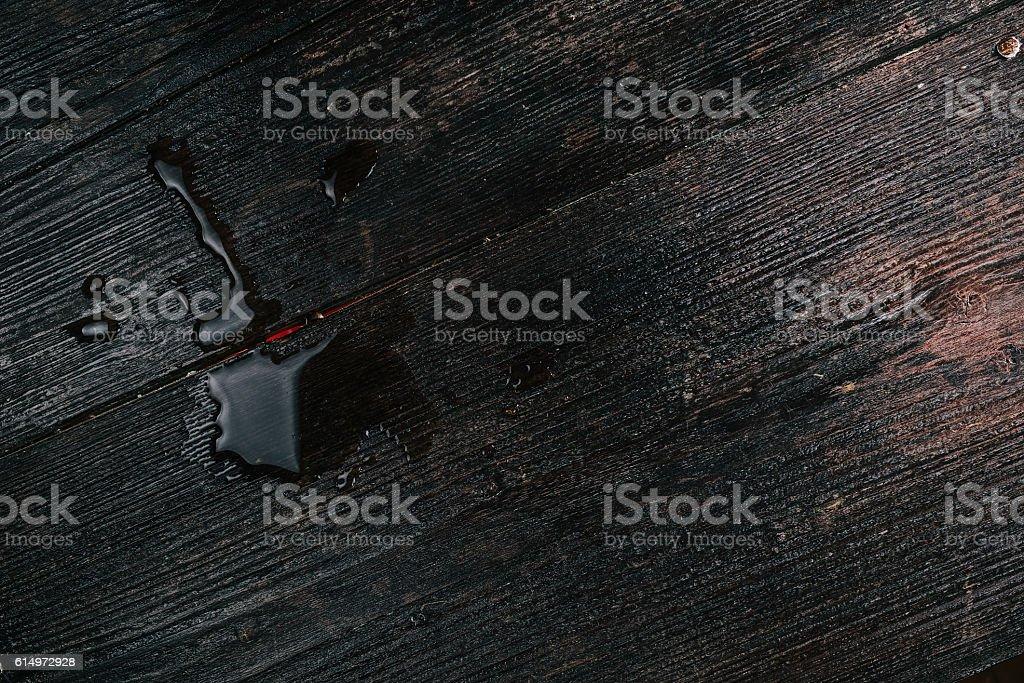 Liquid spot on the dark stock photo
