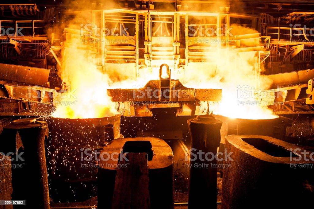 Liquid steel in the tanks stock photo
