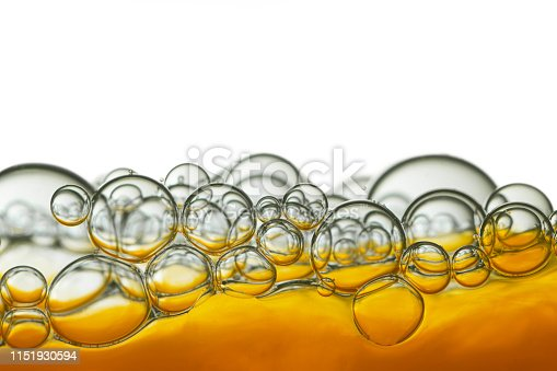 1144550840 istock photo Liquid surface with bubbles 1151930594