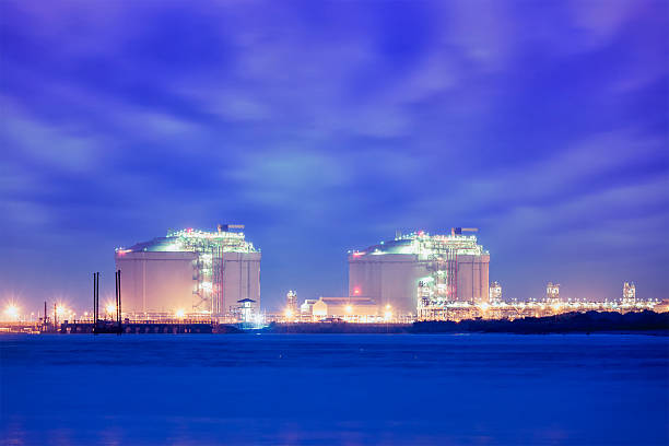 Liquified natural gas LNG tanks in port stock photo