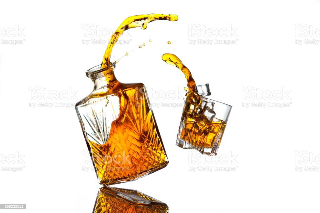 Liquor bottle and glass stock photo