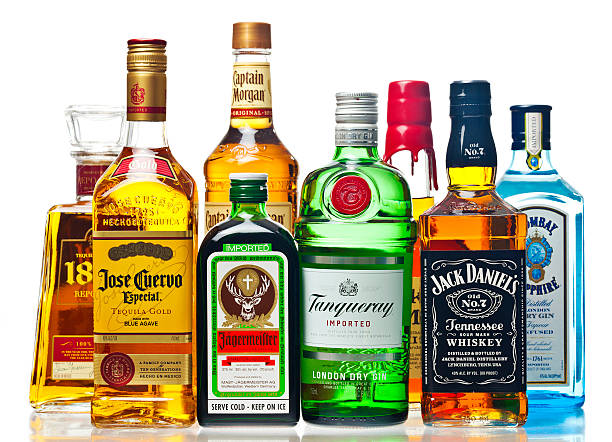 liquor bottles on a white background - alcohol stock photos and pictures