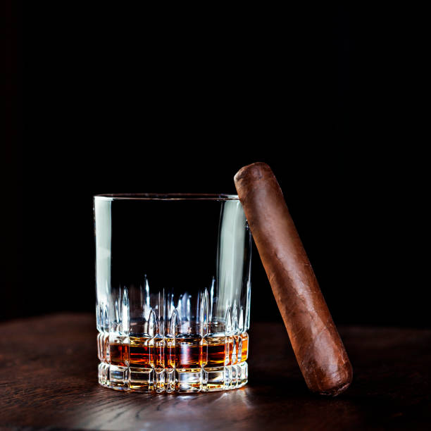 liquor in crystal glass and cigar - tamara dragovic stock photos and pictures
