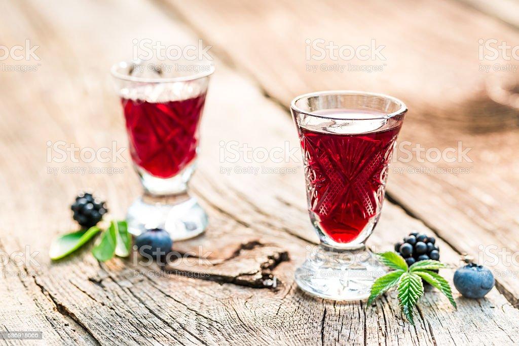 Liquor made of berry fruits and alcohol stock photo
