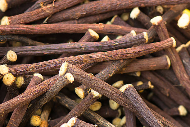 liquorice stick background - liquirizia foto e immagini stock