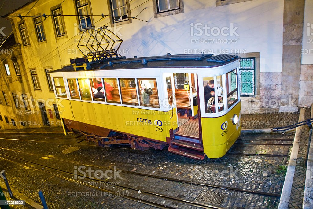 Lisbon at night, famous tram, historic streetcar is running stock photo