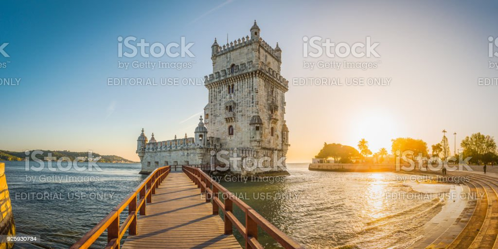 Lisbon Belem Tower waterfront golden sunset Tagus River panorama Portugal stock photo
