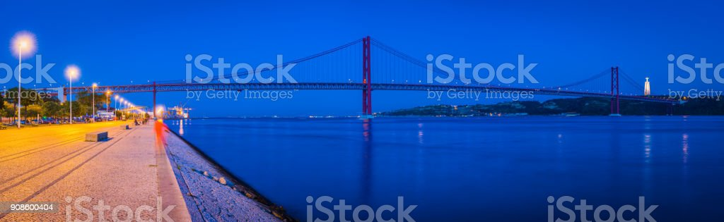 Lisbon Ponte 25 de Abril bridge Tagus night panorama Portugal stock photo