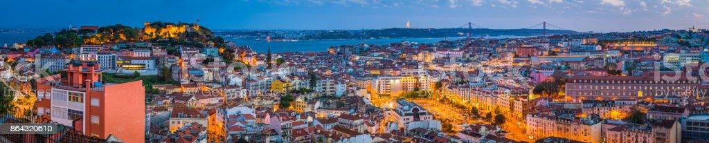 Lisbon cityscape panorama iconic landmarks illuminated at dusk Portugal stock photo