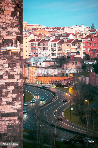 Traffic under the Aguas Livres Aqueduct, seen from Serafina.