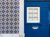 Lisbon house facade with azulejos tiles