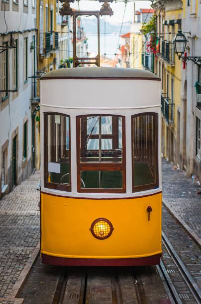 lisbon iconic yellow tram funicular ascensor da bica portugal - eletrico lisboa imagens e fotografias de stock
