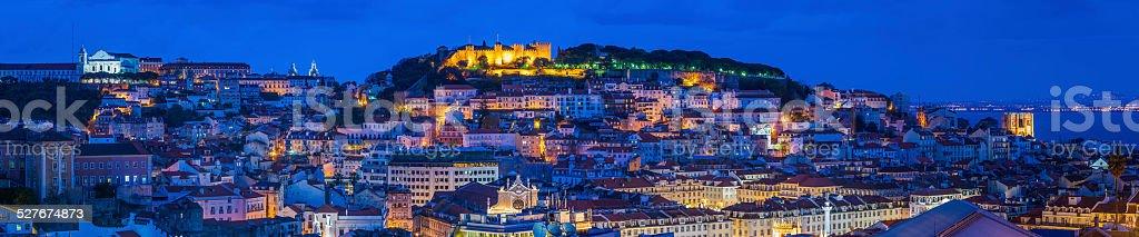 Lisbon landmarks and rooftops illuminated at dusk panorama Portugal stock photo