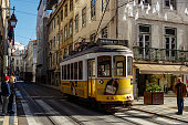 Lisbon, Portugal, January 10, 2020: Lisbon morning cityscape with a typical yellow tram on line 28 in the old part of the city.
