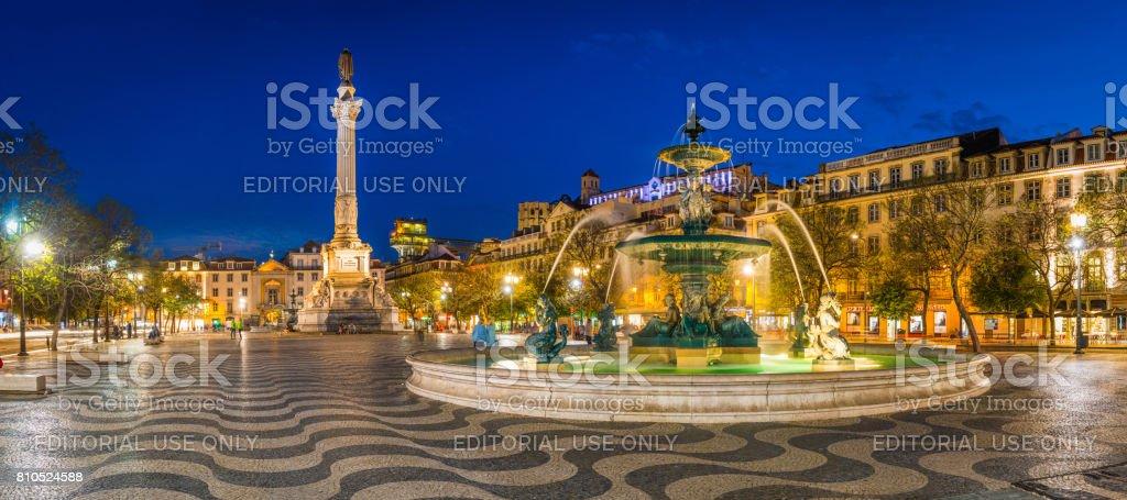 Lisbon Pedro IV Square Rossio fountain monument illuminated panorama Portugal stock photo