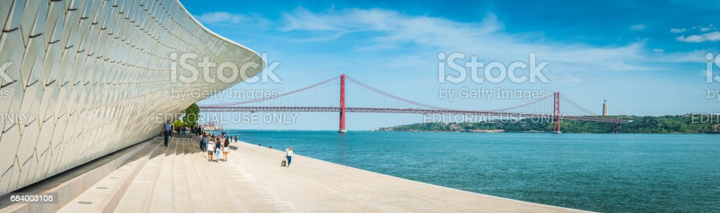 Lisbon people on waterfront beside MAAT museum Belem panorama Portugal stock photo