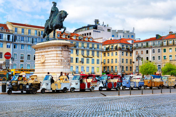 Lisbon, Portugal - 04 17 2015: many tuk-tuks wating for tourists on John I of Portugal Place in Lisbon, Portugal stock photo