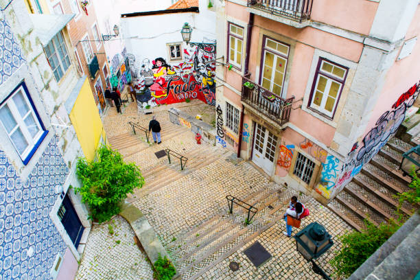 Lisbon, Portugal - 05 06 2016: narrow street and stairs of Lisbon in Alfama district stock photo