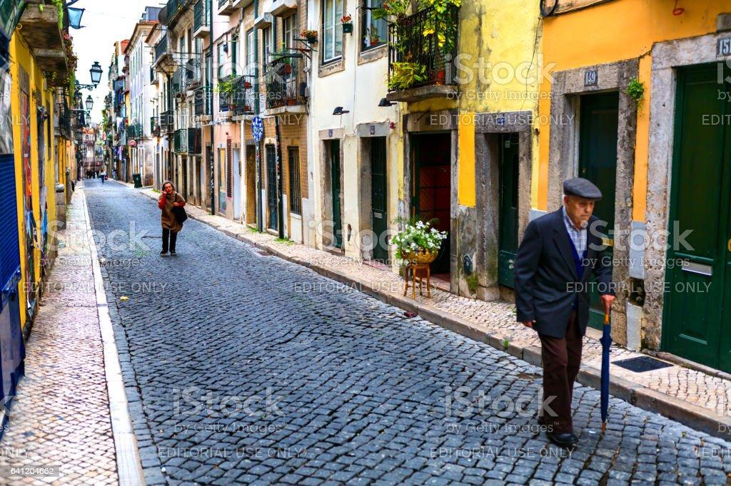 Lisbon, Portugal - 05 06 2016: People walking on a narrow street of Lisbon in Bairro Alto district stock photo