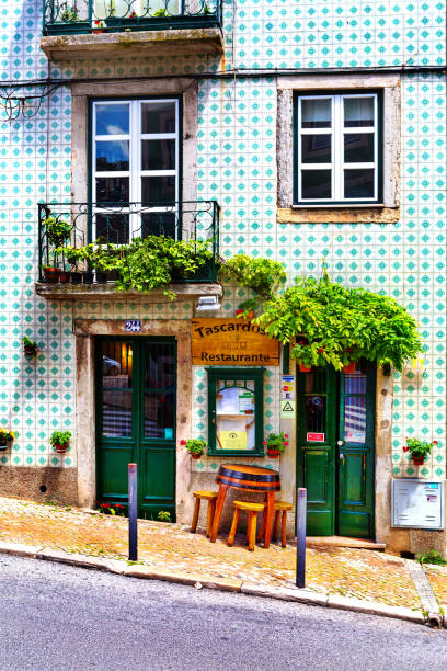 Lisbon, Portugal - 05.13.2016: facade and entrance to the little traditional portugese restaurant located on sloping street in Lisbon, Portugal stock photo