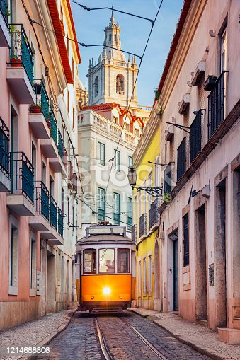Cityscape image of street of Lisbon, Portugal with yellow tram.