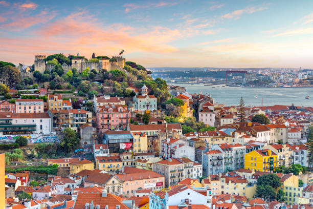 Lisbon, Portugal skyline Lisbon, Portugal skyline at Sao Jorge Castle at sunset. iberian stock pictures, royalty-free photos & images