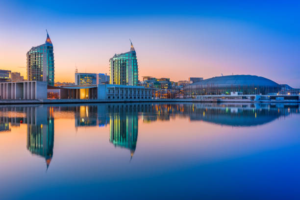 Lisbon, Portugal: Sunset at The Nations Park (Parque das Nações) in Lisbon. Modern buildings and Altice Arena mirrored in the water stock photo
