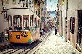 Lisbon, Portugal, 2015 04 17 - yellow tram - elevador da Bica standing on top of the rails