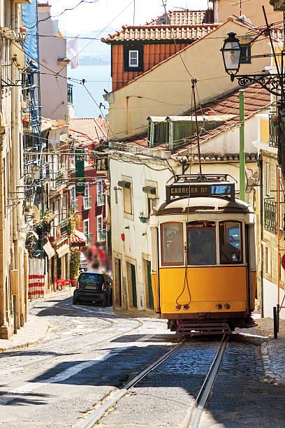 gelbes tram auf der straße von lissabon - lissabon reise stock-fotos und bilder